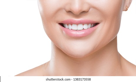 Closeup view of a woman's smile with white healthy teeth, isolated on white. Teeth health concept