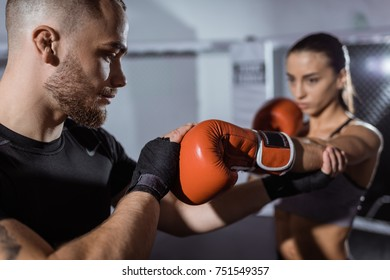 close-up view of young couple of boxers training together