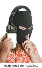 Closeup view of a young girl wearing a ski mask, listening to illegal music, isolated against a white background.