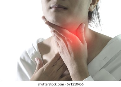 Closeup view of a young woman with Sore throat or pain on neck or thyroid gland. isolated on white background. People body problem concept