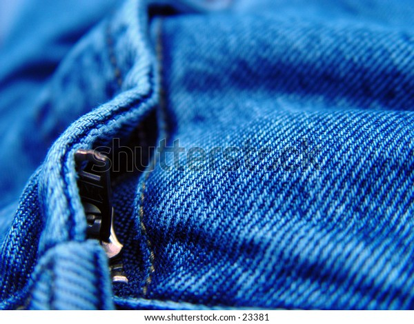 Closeup view of a zipper on a pair of blue jeans