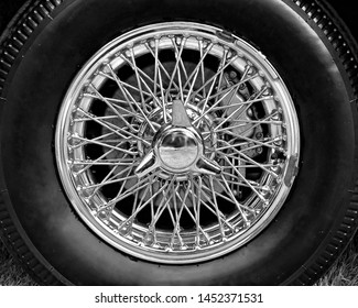 Closeup of vintage car wire wheel in black and white