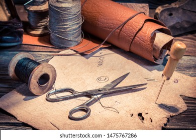 Closeup of vintage cobbler workplace with shoes, laces and tools