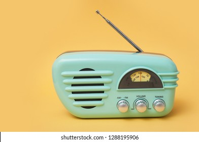 closeup of vintage fifties style radio on yellow background