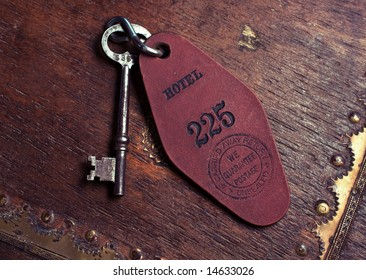 closeup of a vintage hotel room skeleton key.