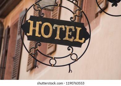 closeup of vintage hotel signage on metallic panel
