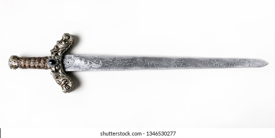 Closeup of vintage metal sword decorated with gems isolated on white background