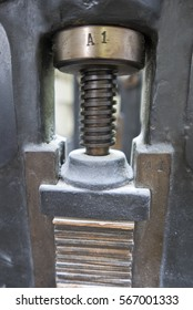 Closeup of vintage Press printing machine in old old printing workshop.