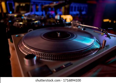 Close-up, vintage record player. Vinyl record player in a nightclub. Music plate.