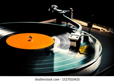 Close-up vintage record player, While playing the record, Black platter.
