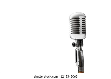 Close-up of vintage retro microphone isolated on white background