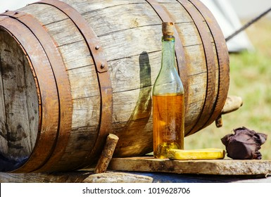 Closeup of vintage wooden barrrel and cider bottle on table at outdoor
