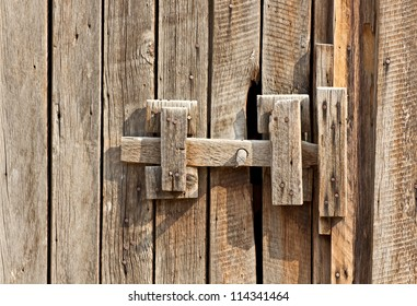 Closeup of a vintage wooden latch on a building