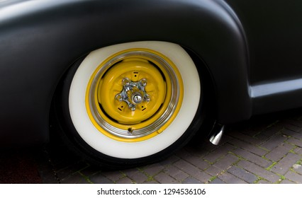 Closeup of a vintage yellow classic car tyre at an oldtimer exhibition