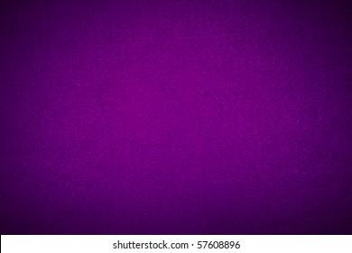 Close-up of violet poker table felt background