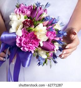 Close-up of vivid wedding bouquet at bride's hands
