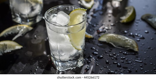 Closeup vodka in a glass with ice, lime vodka, Gin, tonic, tequila