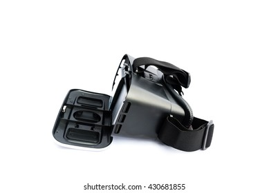 Close-up of VR Glasses or Virtual Reality Headset pair with smartphone. VR is an immersive experience in which your head movements are tracked in 3d world, making it ideally suited to game and movie.