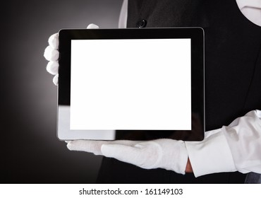 Close-up Of A Waiter Hand Showing Blank Digital Tablet