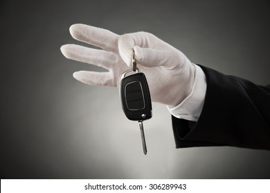 Close-up Of Waiter Hands In White Glove Holding Car Key