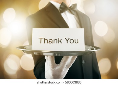 Close-up Of A Waiter Holding Thank You Card In Tray