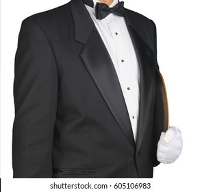 Closeup of a waiter in a tuxedo holding a serving tray under his arm. Horizontal format on a white. Man is unrecognizable.