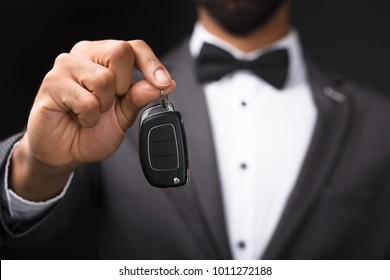 Close-up Of A Waiter's Hand Holding Car Key