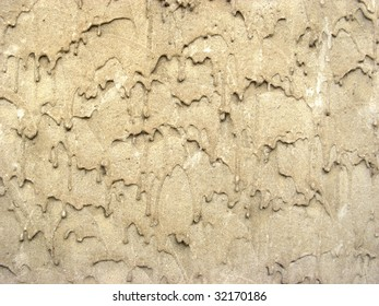 Close-up to a wall plaster with dripped effect, texture background