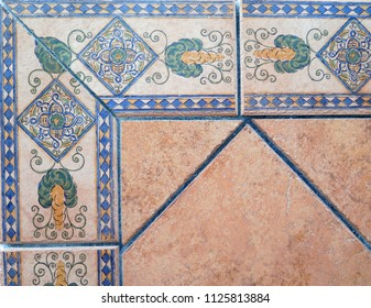 Closeup of Wall tiled with colorful ceramic tiles in village in Andalusia