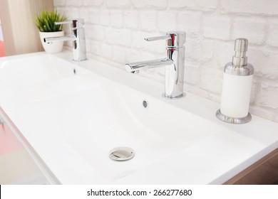 Closeup of a wash basin in a modern bathroom