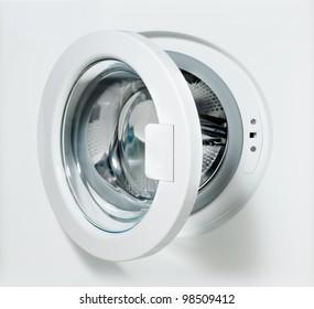 closeup of washing machine door with empty drum