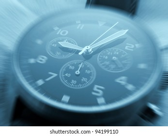 Closeup of watch face with zoom effect and cyan toned