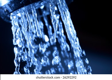 Closeup of water coming out of faucet