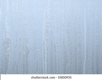 Closeup of water drops on steamed up window