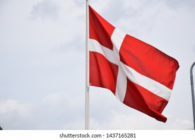 Closeup of 'Dannebrog' waving in the wind, Danish national flag, shrouded summer day, Denmark, Northern Europe