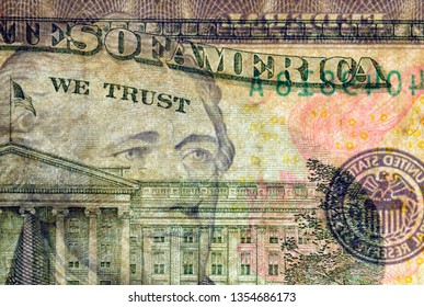Close-up at We Trust text & president Hamilton eyes, highly magnified surface of used 10 dollars note with visible details of cotton fiber paper, with all flaws, watermarks and traces of usage.