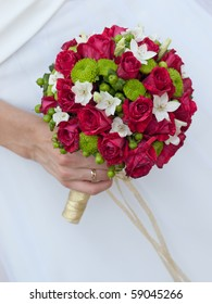 close-up of wedding bouquet at bride's hands