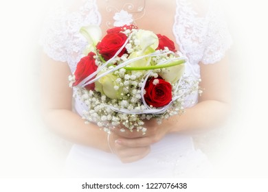 Close-up of a wedding bouquet of red flowers held by the bride.