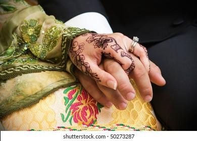 Closeup of wedding couple's hands