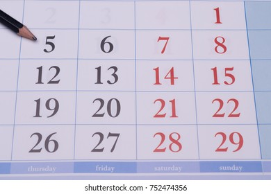 Closeup in the weekly business and formal painted black and red dates