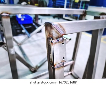Close-up Welded Stainless Steel Square Tube Frame and Plate with Selective Focus