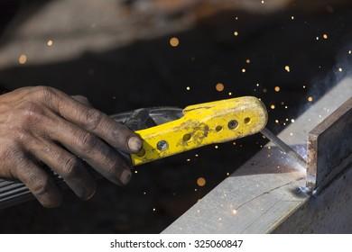 Closeup of welding steel during hot summer