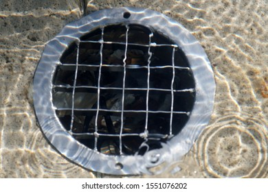 The closeup of a well drain and filter under the water surface.