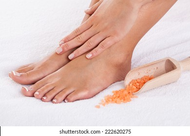Close-up of well-cared  female hands and feet