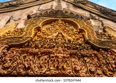 Close-up of the west facing pediment of the east gopura in the 2nd enclosure of Cambodia's Banteay Srei temple, depicting  Gaja Lakshmi sitting on a lotus flower flanked by 2 elephants.