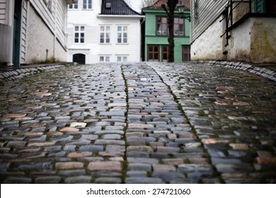Closeup of wet cobblestones on the street in Norway city Bergen