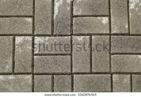 Closeup of wet grey concrete pavement surface texture background top view.