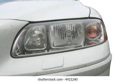 Close-up of wet head light.