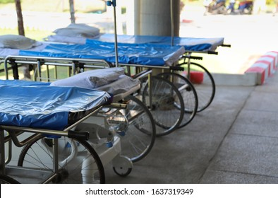 Closeup of wheelbeds and stretchers in front of O.P.D. of the hospital preparing for emergency medical service and mass casualty.
