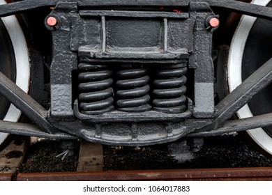 close-up of wheels on an antique steam train waiting to leave the station